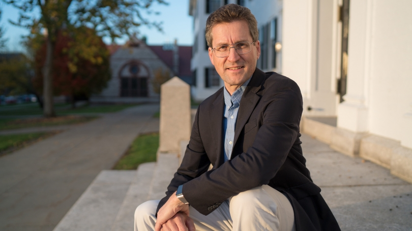David Kotz sitting on steps of Dartmouth Hall