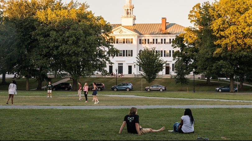 Students relaxing and playing on the Green