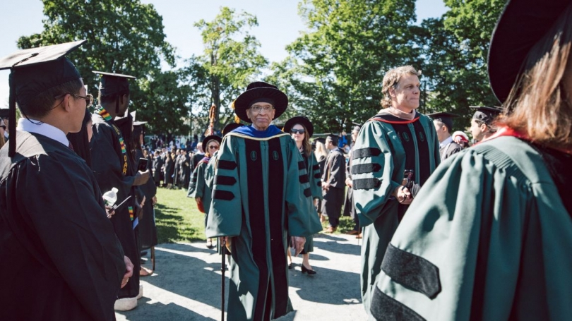 At center, Trustee James Jackson marches with Trustee Jeffrey Blackburn '91 during last year's commencement ceremony.