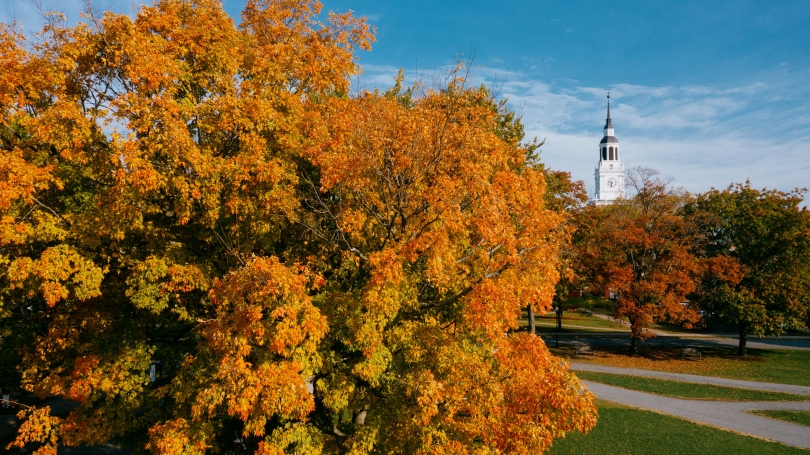 Baker Tower surrounded by orange, yellow, and green foliage