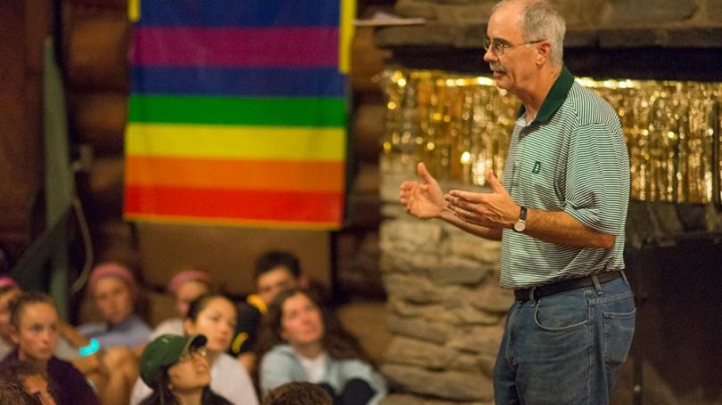 President Hanlon speaking to a group of students at Moosilauke Ravine Lodge.