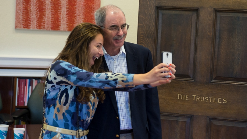 President Hanlon has his picture taken with a first-year student.