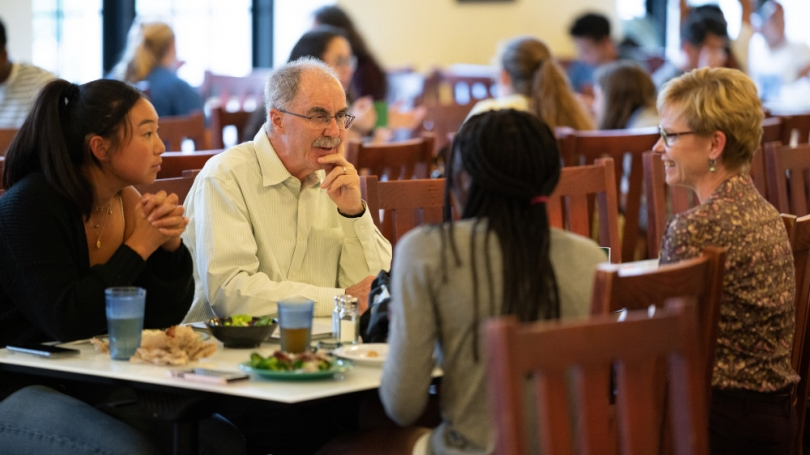 President Hanlon eating with students in the Class of 53 Commons.