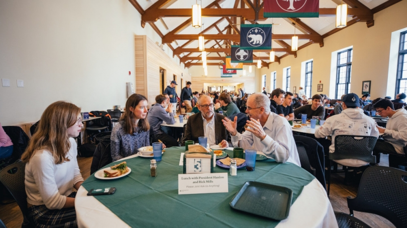 President Hanlon and Rick Mills eating with students in the Class of 53 Commons.