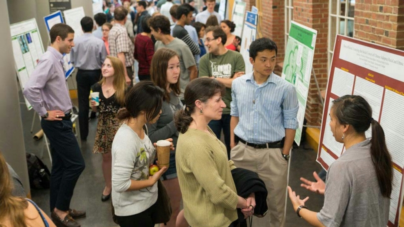 Students gathered for a research poster session.