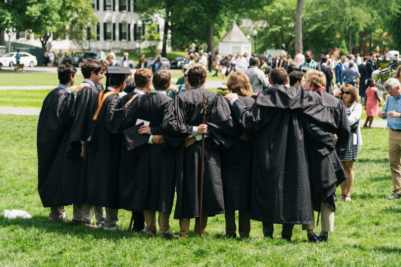 Dartmouth students stand in the Green for photos after Commencement
